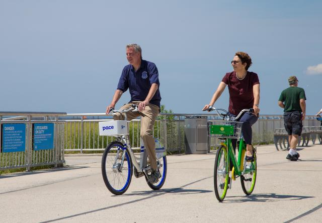 Mayor Bill de Blasio and DOT Commissioner Trottenberg trying the dockless bikes in the Rockaways, last summer.