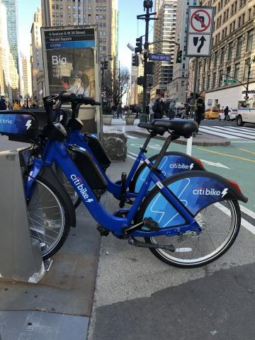 Two electric bikes at a station in midtown