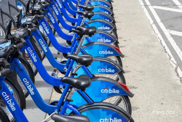 A row of Citi Bikes parked at a station